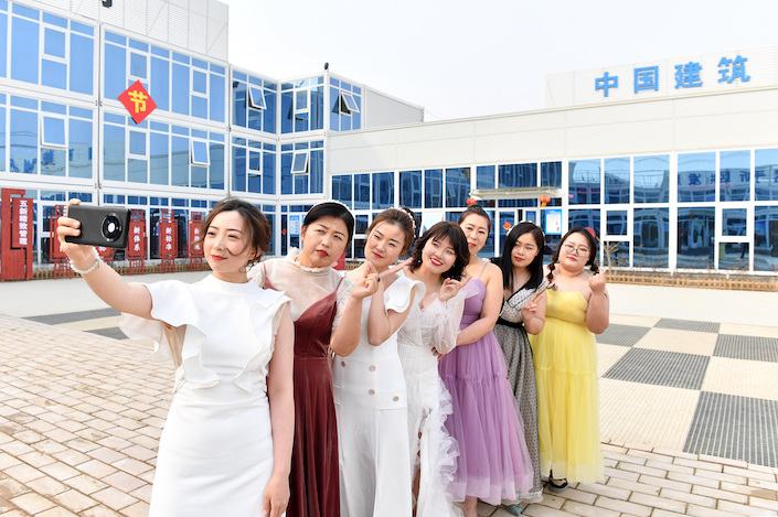Female workers at a construction company in Xiong'An, Hebei province, celebrate International Women's Day.