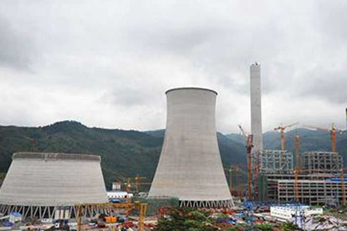 Chongqing Energy on Tuesday suspended trading of $500 million 5.625% bond due in 2022 and said in a filing that it is proactively exploring debt resolution options. Photo: Chongqing Energy Investment