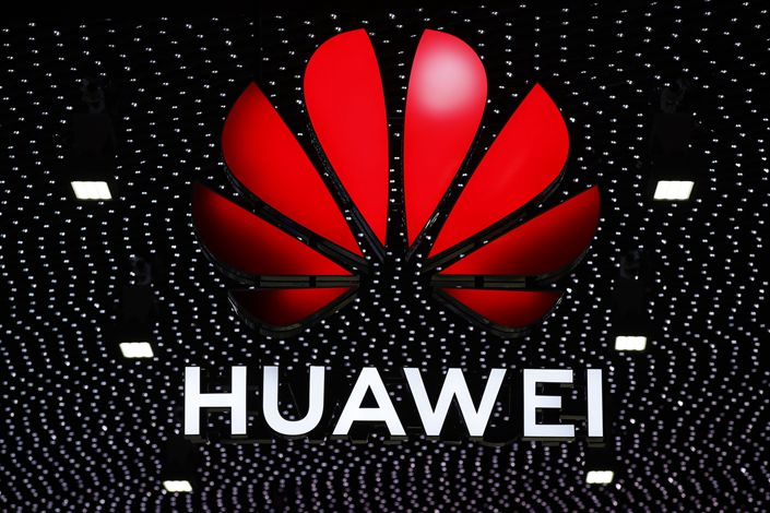 An illuminated logo stands above the Huawei stand during the opening day of the MWC Barcelona in Barcelona, Spain, on Feb. 25, 2019.  Photo: Bloomberg