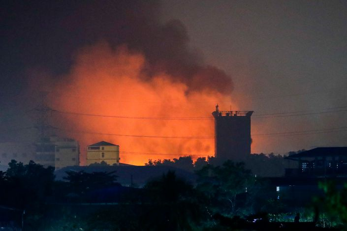 Burning factories light up an industrial neighborhood on the outskirts of Yangon, Myanmar, on Monday. Photo: The Paper