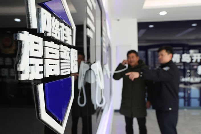 Chinese police said they've arrested 13 scammers who used a cryptocurrency trading platform to launder their illicit gains. Photo: VCG