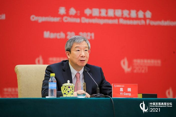 Yi Gang, governor of the People's Bank of China, speaks at the China Development Forum on March 20. Photo: China Development Forum