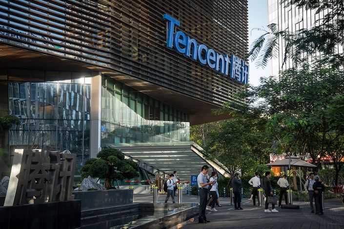 People gather outside the Tencent Binhai Mansion in Shenzhen
