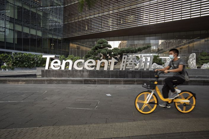 A cyclist rides past the Tencent Holding Ltd.headquarters in Shenzhen