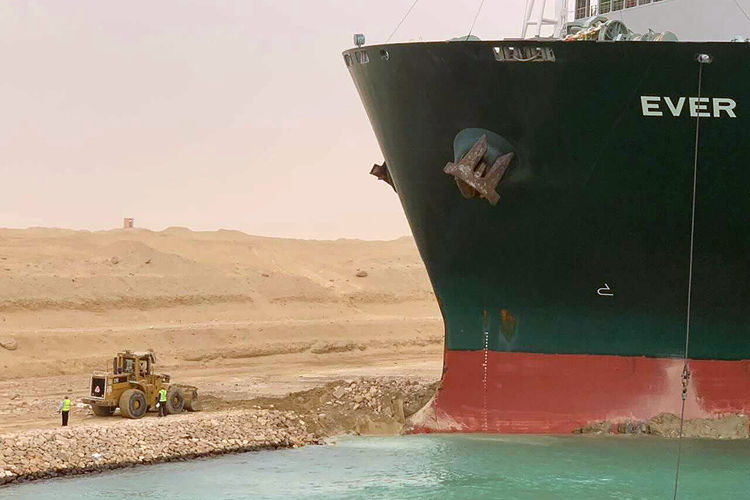 Rescue teams work on floating the container ship which ran aground in the southern part of the Suez Canal on Mar. 23