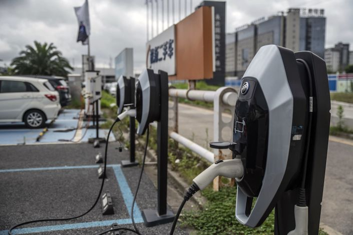 Charging stations for General Motors Co. Buick Velite electric vehicle (EV) stand outside the company's dealership in Shanghai.
