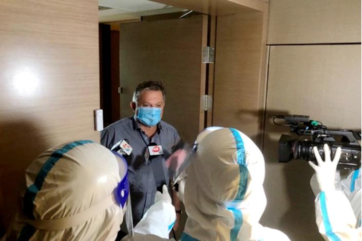 David Mahon meets the Chinese press at his hotel during quarantine.