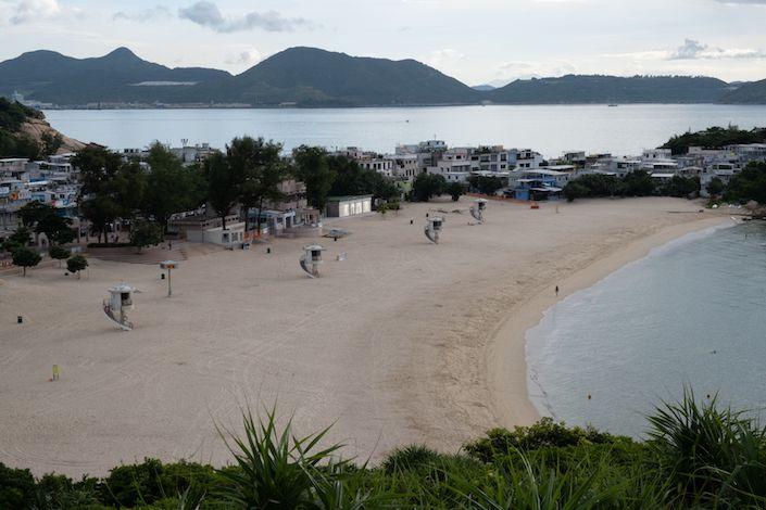 Shek O beach stands empty in Hong Kong