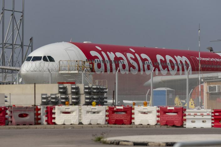 An AirAsia aircraft sits parked at Hong Kong International Airport on March 15, 2020. Photo: VCG