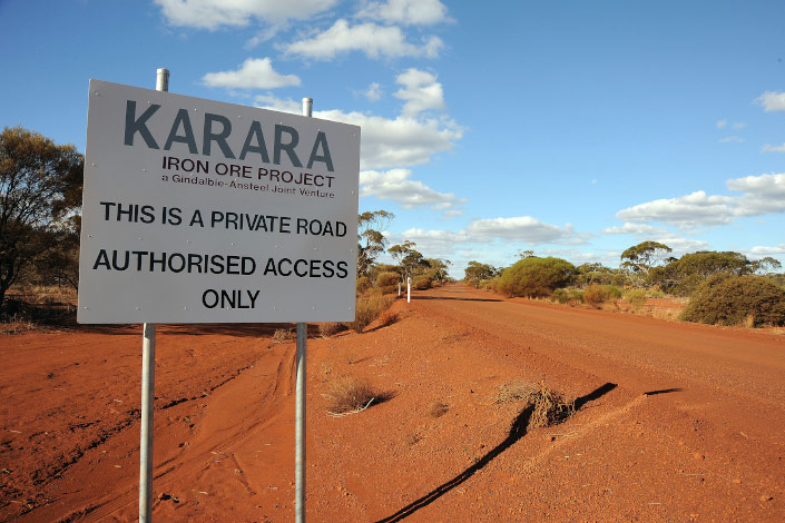 A sign marks the entrance to an iron ore project in Australia in June 2010. Photo: VCG
