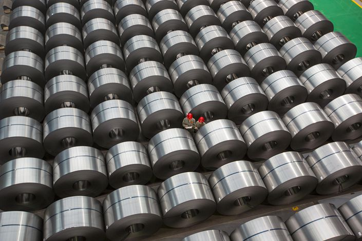Workers examine cold-rolled steel on March 22 at the production site of a steel company in Liuzhou, South China's Guangxi Zhuang autonomous region. Photo: VCG
