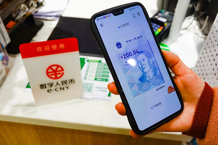 Under a one-day central bank-sponsored pilot program, Hong Kong residents were allowed to use the virtual yuan to make payments in neighboring Shenzhen. Photo: VCG