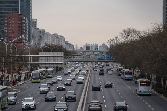 Vehicles travel along Chang'an Avenue in Beijing on March 6. Photo: Bloomberg
