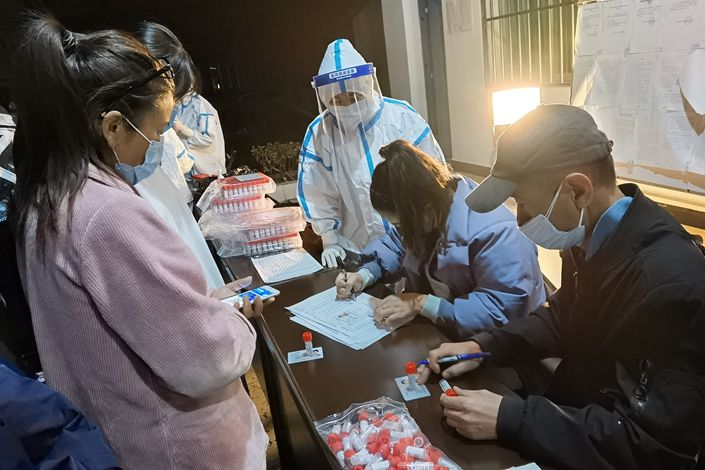 Residents register for coronavirus tests in Ruili, Yunnan province, on March 31. Photo: VCG