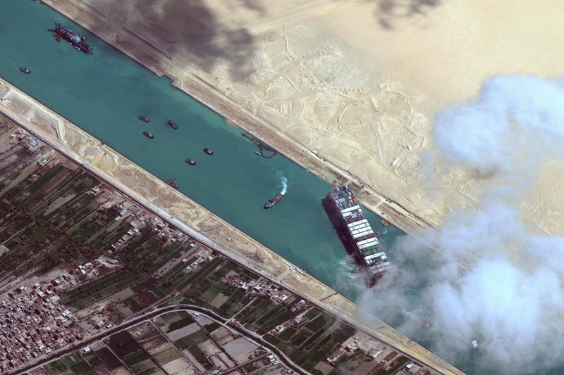 This satellite imagery released by Maxar Technologies shows an overview of the MV Ever Given container ship and tugboats in the Suez Canal on March 29