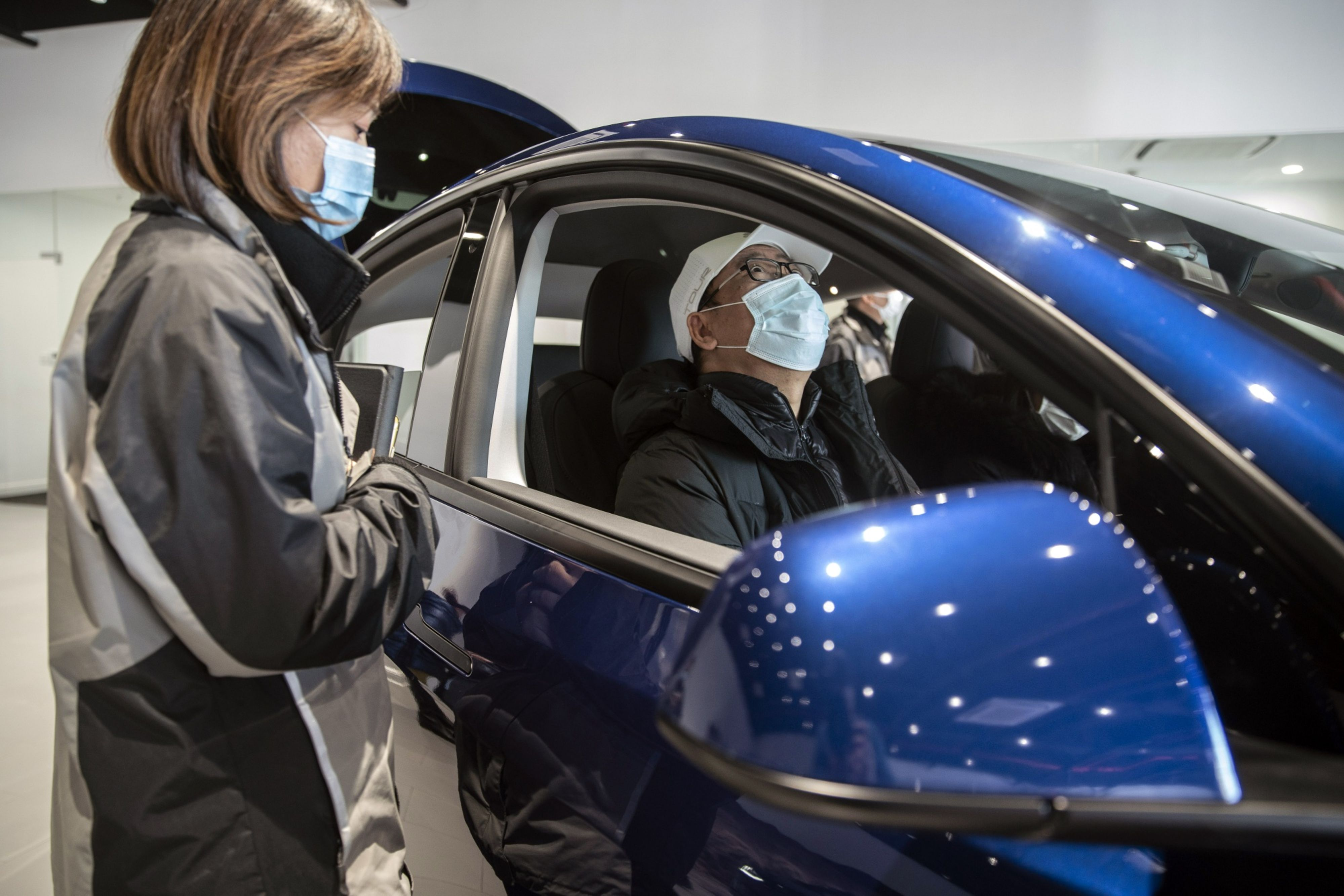 A customer sits inside a Tesla Model Y at the automaker's showroom in Shanghai. Photo: Bloomberg