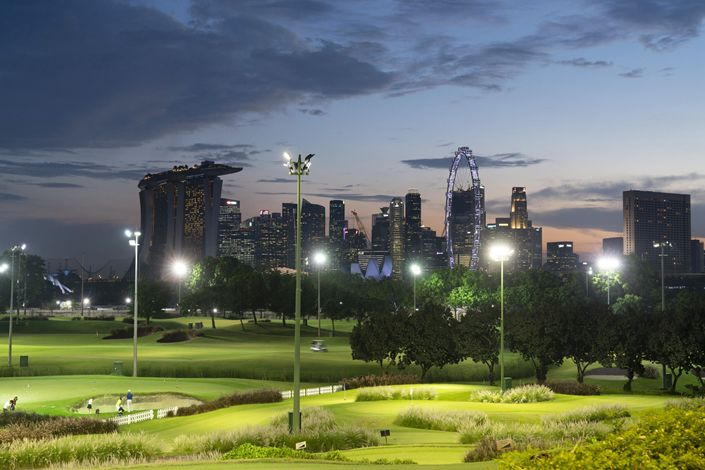 Golfers play evening rounds at the Marina Bay Golf Course, a public course near the CBD in Singapore, on April 6. Photo: Bloomberg