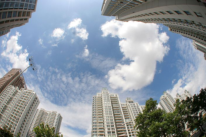 A total of 22 Chinese cities, including Beijing, Shanghai, Guangzhou and Shenzhen, have been instructed to announce plans to hold no more than three auctions each year for land for residential use. Photo: VCG