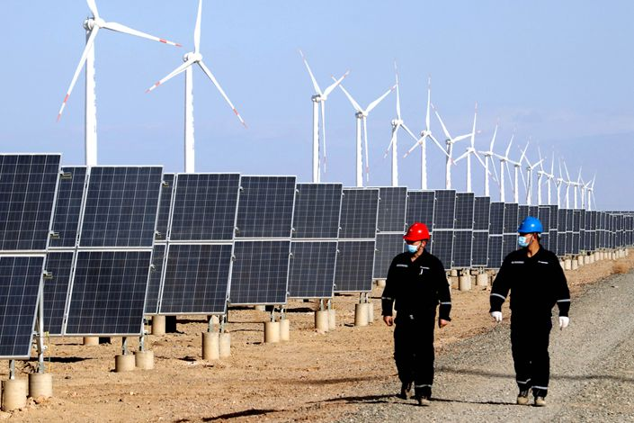 A staff member inspects a wind-solar power station in Hami, Northwest China's Xinjiang Uygur autonomous region, on Feb. 12. Photo: IC Photo