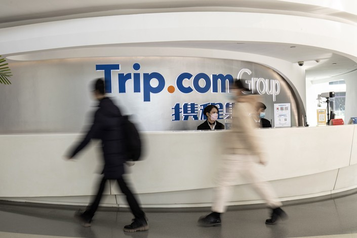 Employees walk through the reception area at the Trip.com Group Ltd. headquarters in Shanghai on Feb. 4. Photo: Bloomberg