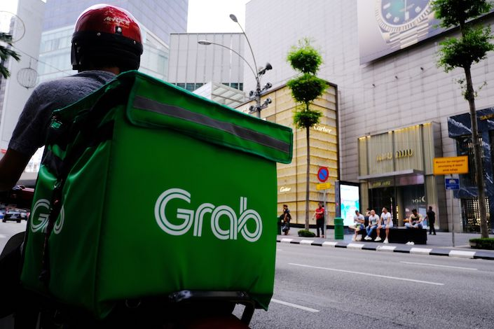 A Grab Holdings Inc. driver waits for an order in the Bukit Bintang district of Kuala Lumpur