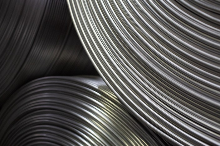 Coils of aluminum wire sit at a smelting plant in Shelekhov, Russia, on April 9.  Photo: Bloomberg