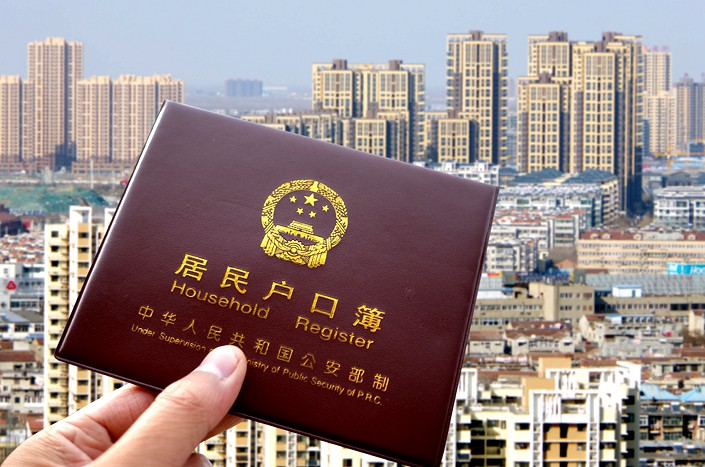 China's household registration system allows a person to access key public services such as education and health care within the area covered by their registration. Photo: VCG