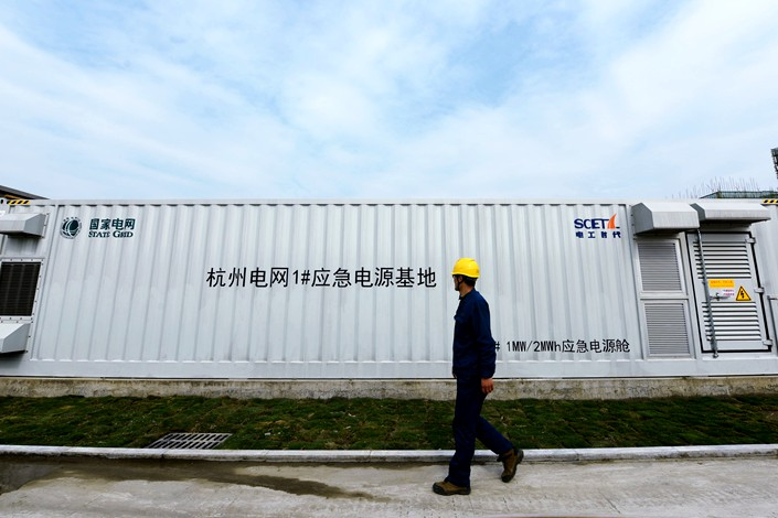 A member of State Grid staff looks at an energy storage facility in Hangzhou on April 7, 2021. Photo: IC Photo