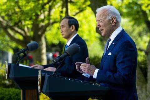 U.S. President Joe Biden and Japanese Prime Minister Yoshihide Suga speak at a press conference Friday at the White House. Photo: People's Daily