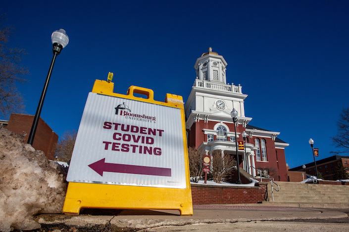 A sign directing students to the Covid-19 testing site at the campus of Bloomsburg University in Pennsylvania.