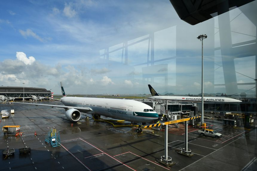 Tickets for Singapore Airlines and Cathay Pacific's one-way direct flights from Singapore to Hong Kong have sold out from May 26 to June 4. Photo: The Straits Times