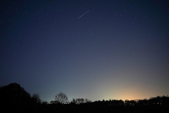 A Starlink satellite seen across the night sky over the U.K. April 21, 2020.