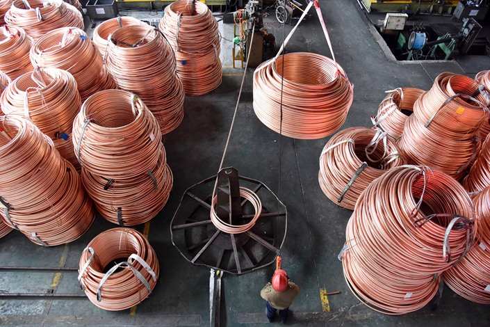 A worker processes a copper belt in February 2020 in Wenzhou, East China's Zhejiang province. Photo: VCG