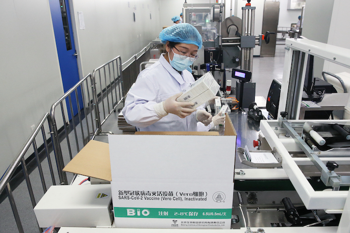 Workers package Covid-19 vaccines at Sinopharm affiliate Beijing Institute of Biological Products.