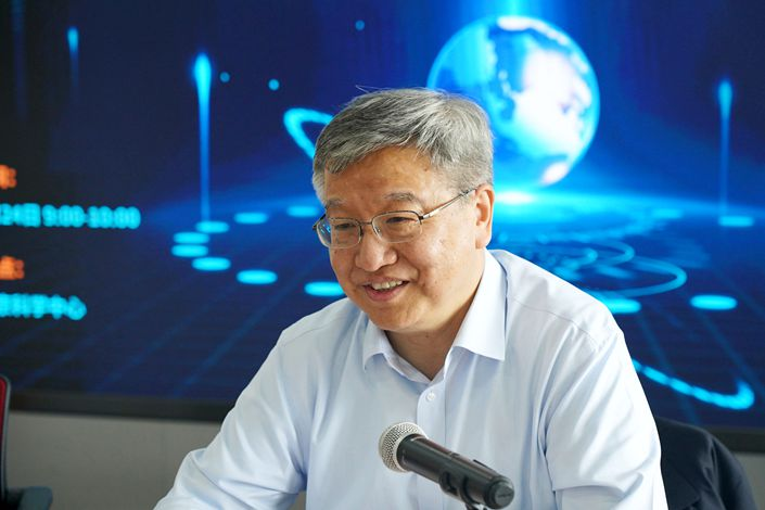 Xie Jun, deputy chief designer of Beidou major special projects, interacts with reporters at the Beijing Science Center on April 24. Photo: VCG