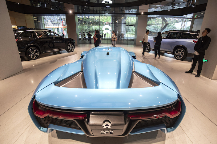 A Nio Inc. EP9 sports car stands on display inside the Nio House showroom at the Shanghai Tower in Shanghai