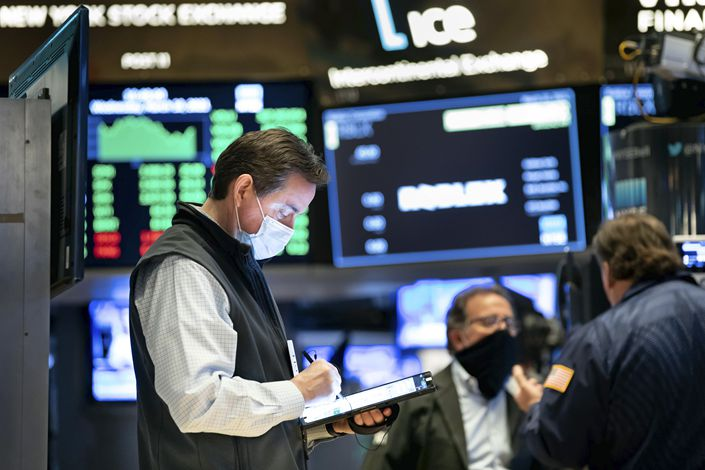 Traders work on the floor of the New York Stock Exchange on March 10. Photo: VCG