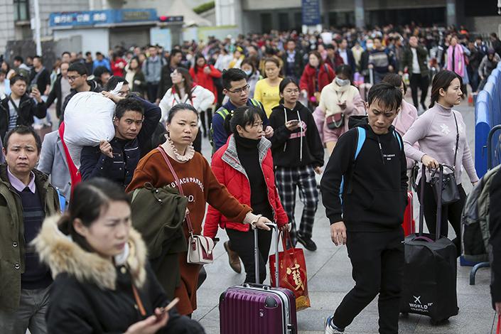 Travelers pass through Guangzhou Railway Station in 2019. Photo: VCG