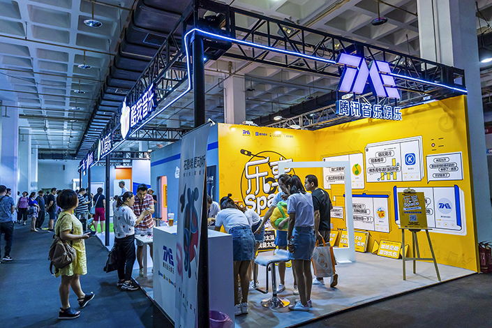 Visitors check out a TME booth in Beijing in July 2018. Photo: VCG