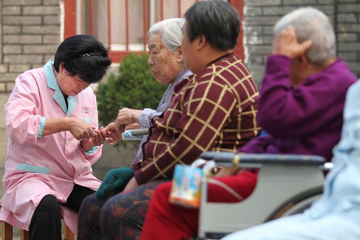 Essentially, China's elderly care problem can only be solved by optimizing the population structure and improving productivity, writes Caixin Editor-in-Chief Wang Shuo. Photo: VCG