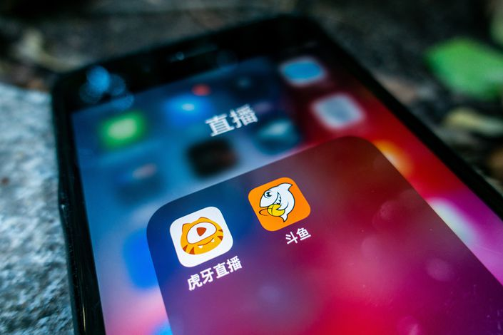 The future of the two top players in China's game livestreaming scene remains uncertain. Photo: VCG