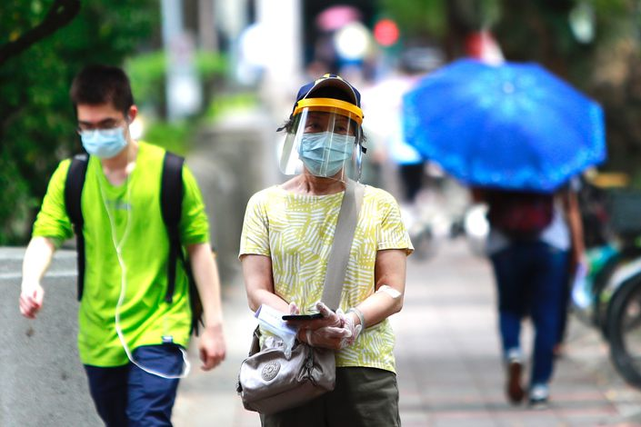 People walk down a street in Taipei, Taiwan on May 17. Photo: VCG
