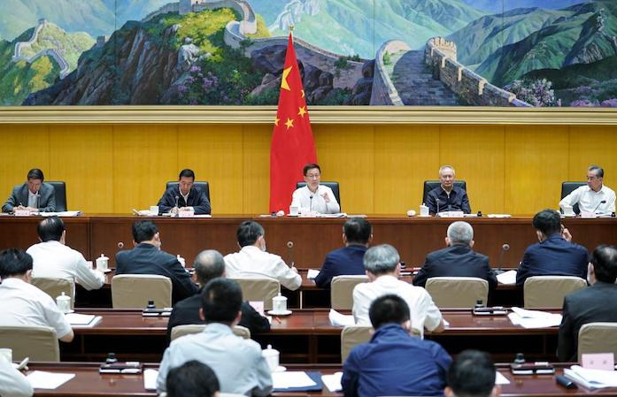 Vice Premier Han Zheng (middle) speaks while presiding over the first plenary meeting of a leading group on carbon peak and carbon neutrality in Beijing, May 26, 2021. Photo: Xinhua