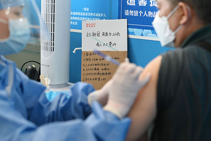 A resident receives a Covid-19 vaccine Thursday at a temporary vaccination center in Guangzhou, South China's Guangdong province. Photo: Chen Chuhong/China News Service/VCG