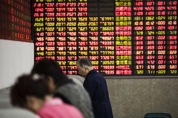 Investors at a securities brokerage in Shanghai