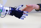 脑机接口唤起触觉反馈 提升患者操作机械臂灵活度