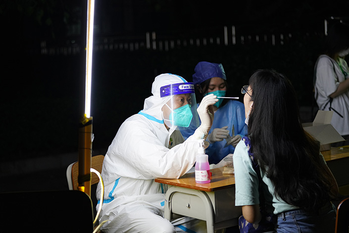 Zhongshan residents take Covid-19 tests on June 7. Photo: VCG