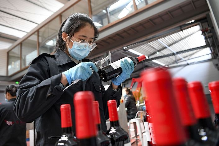 A staff member conducts sampling inspection to the finished wine products at the Xige Estate in northwest China's Ningxia Hui Autonomous Region