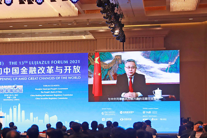 Guo Shuqing, secretary of the Communist Party Committee of the People's Bank of China and chairman of the China Banking and Insurance Regulatory Commission, delivers a speech via video to the 13th Lujiazui Forum in Shanghai on June 10, Photo: IC Photo