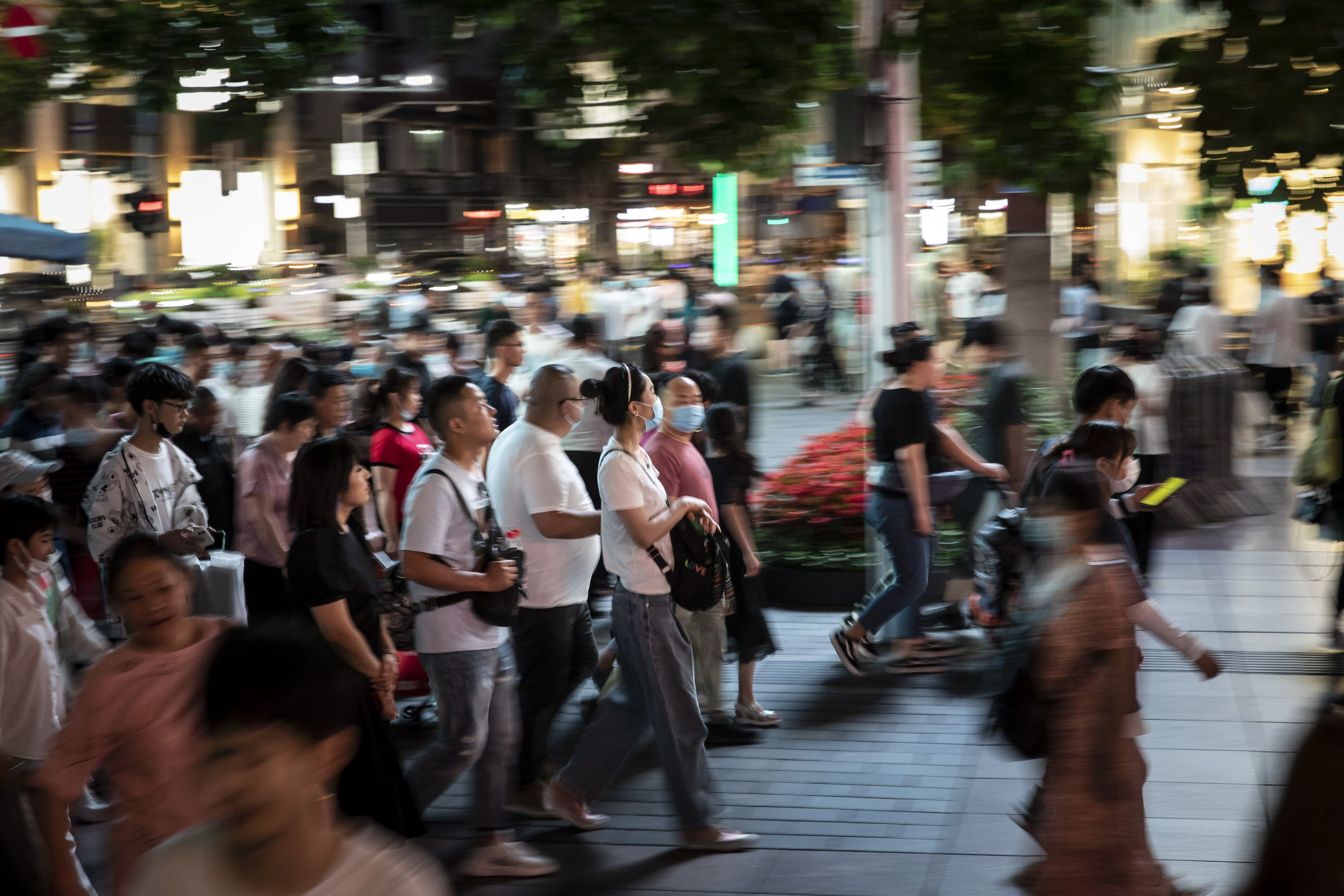 Shoppers and pedestrians walk along Nanjing Road in Shanghai. Photo: Bloomberg